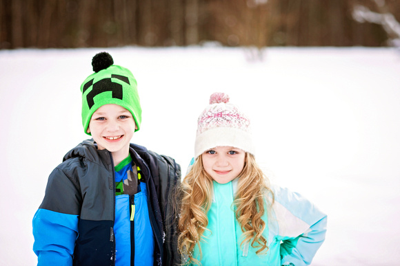 brother and sister in the snow